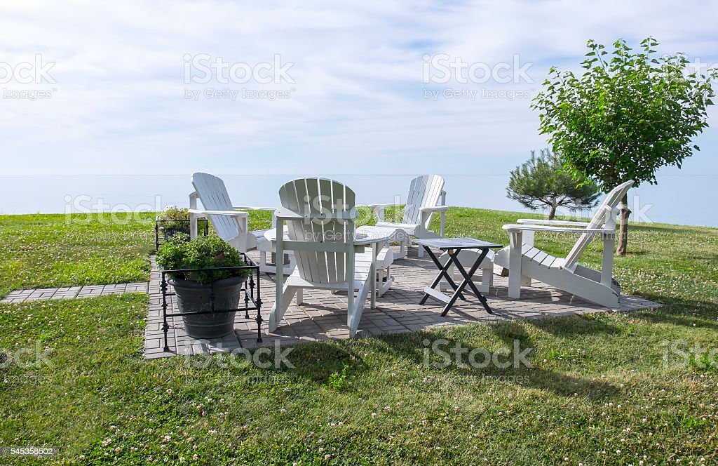White Adirondack Chairs by Lake Erie stock photo