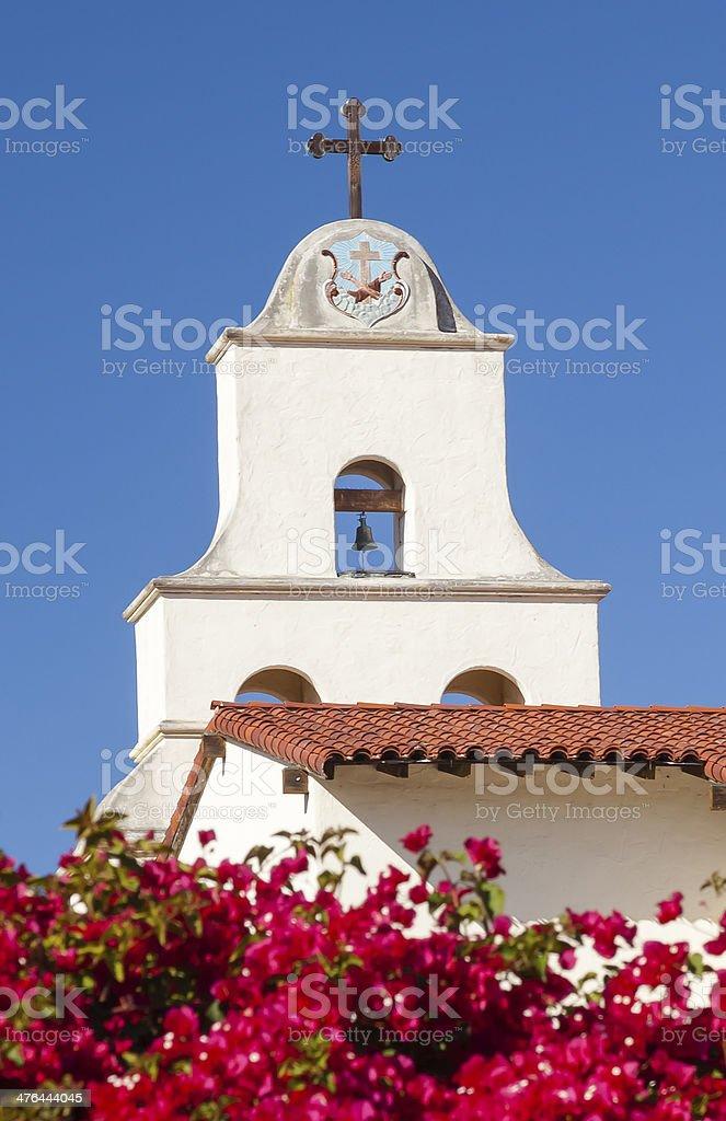 White Adobe Mission Santa Barbara Cross Bell Bougainvillea California stock photo