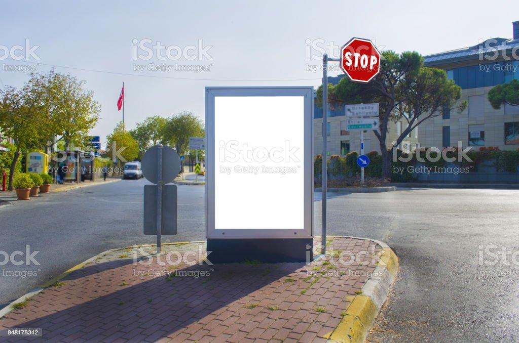 white advertising panel at traffic junction stock photo