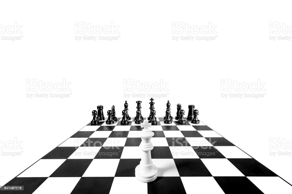 white against black pieces surrounded King stock photo