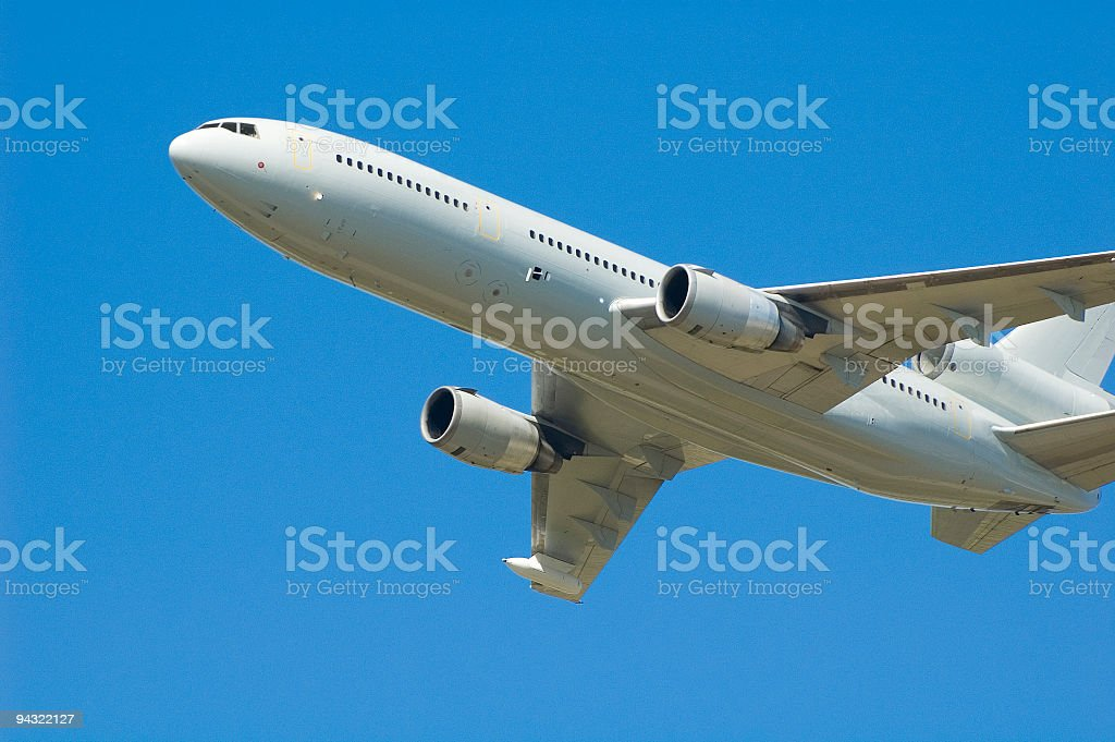 White airliner, blue sky royalty-free stock photo