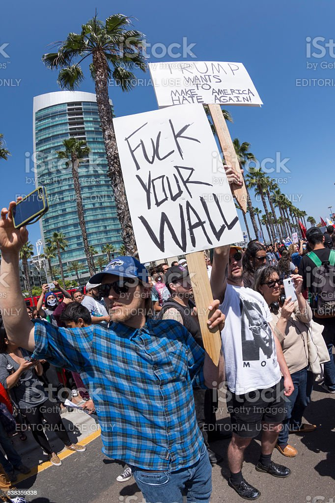 White American against the Trump wall stock photo