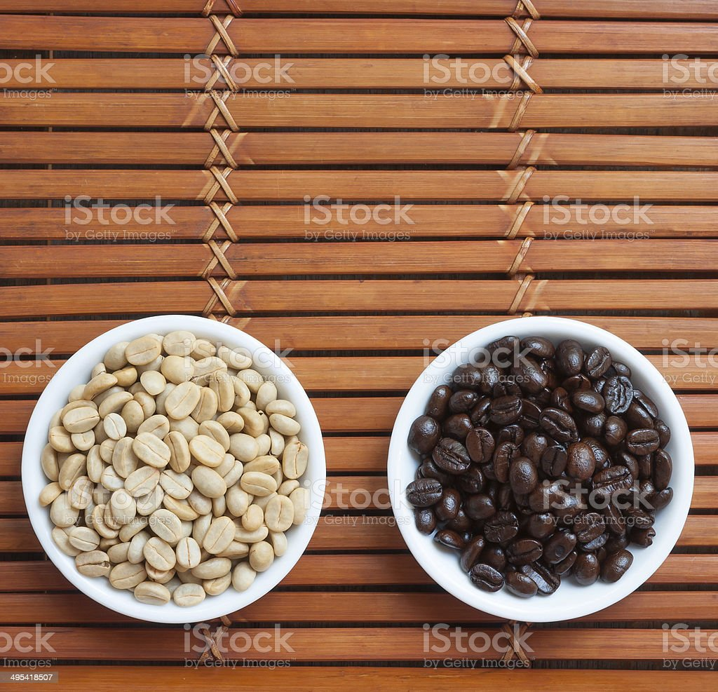 White and black  arabica coffee beans stock photo