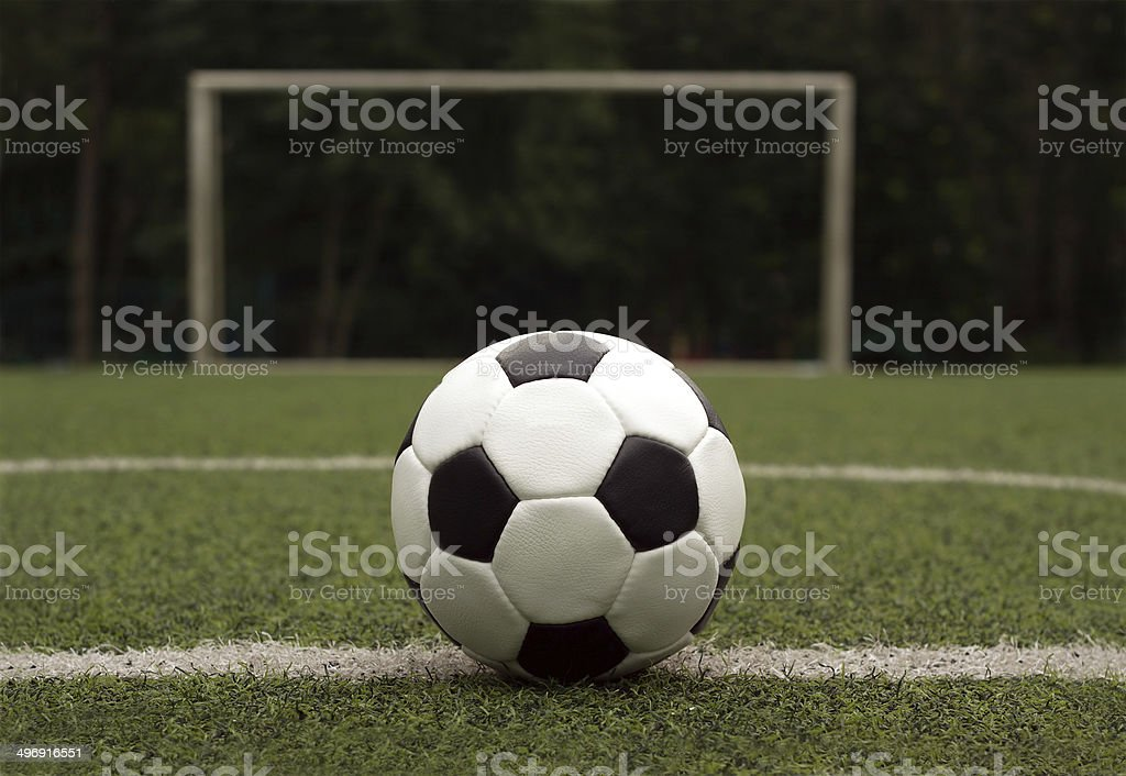 White and black ball for playing soccer against gate close-up royalty-free stock photo