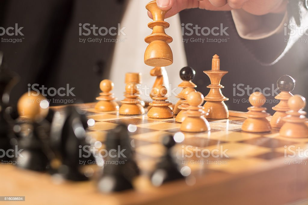 White and black chess piece in the chess board stock photo