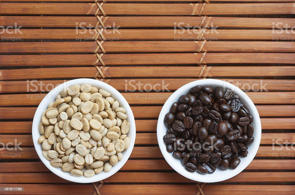 White and black coffee beans stock photo