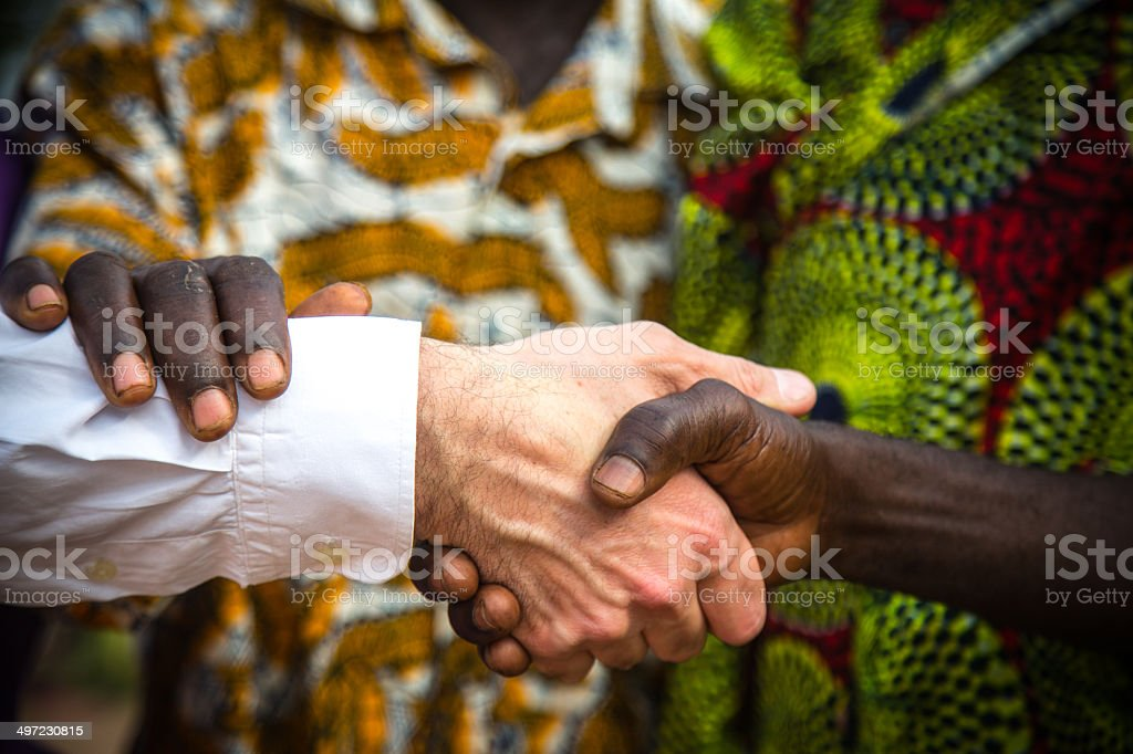 White and black hand shaking hands royalty-free stock photo