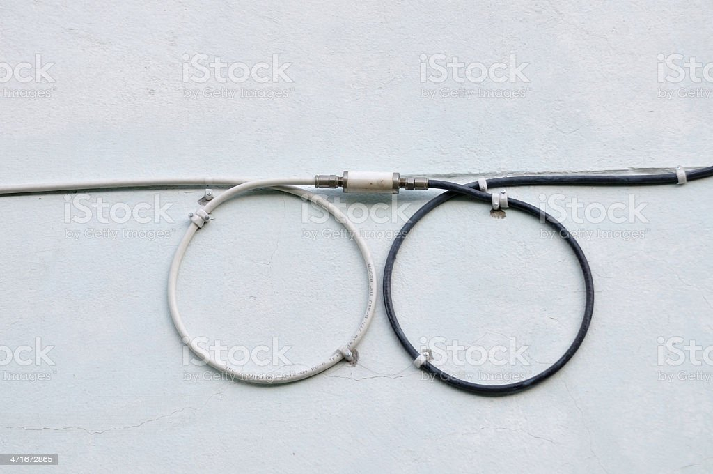 White and black signal wires for TV digital connects together. royalty-free stock photo