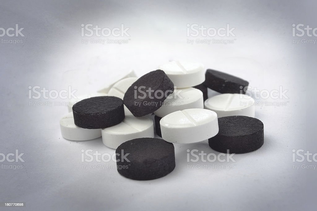 White and black tablets royalty-free stock photo