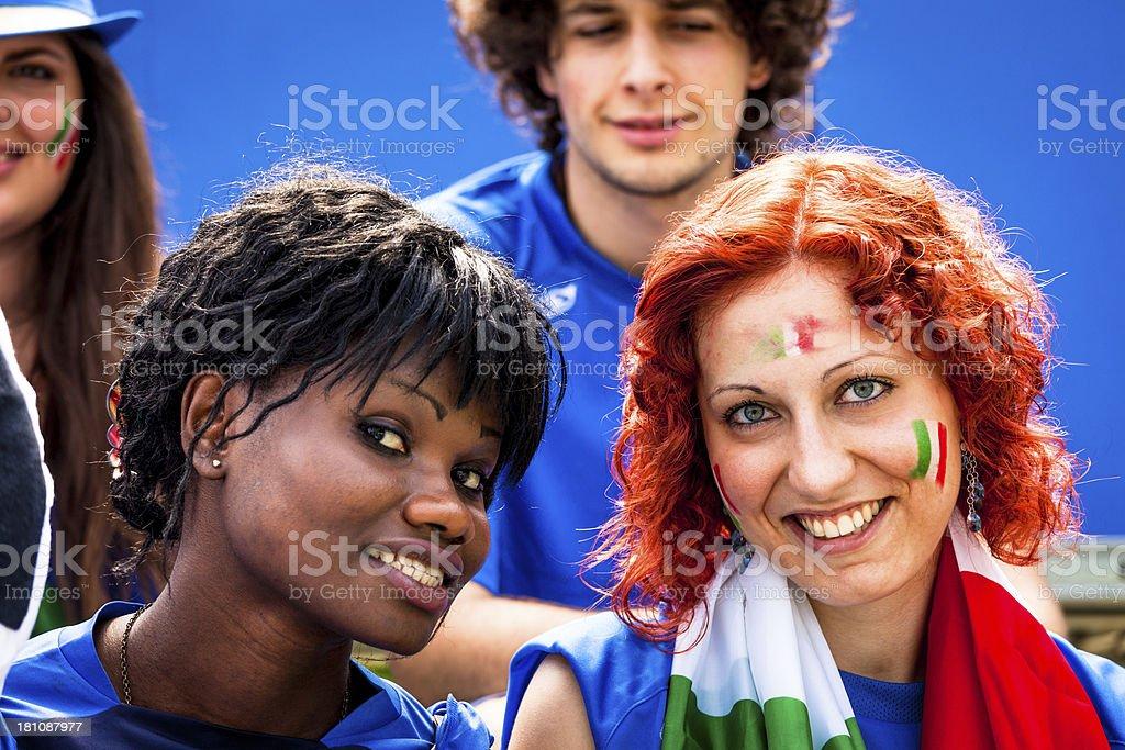 White and Black Woman Fan of Italian Footbal Team royalty-free stock photo