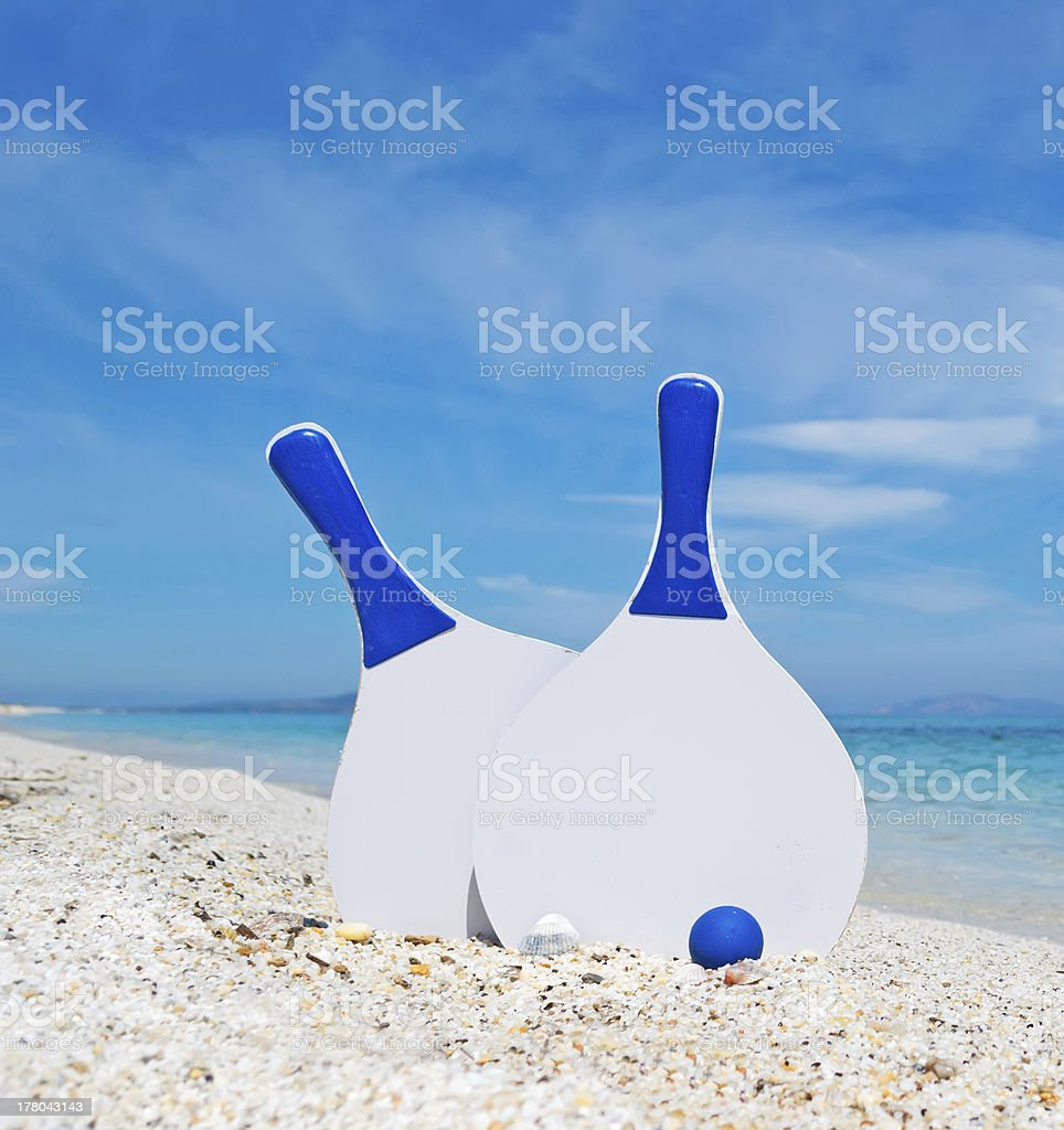 white and blue beach rackets stock photo