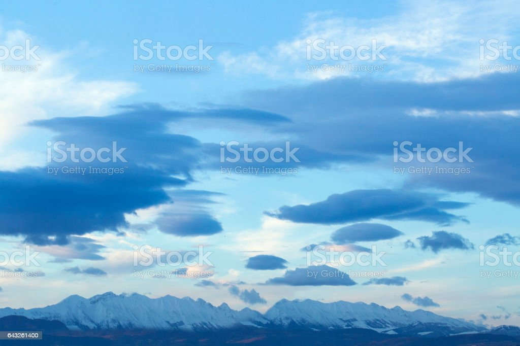 white and blue clouds seems brushstrokes the light blue sky stock photo