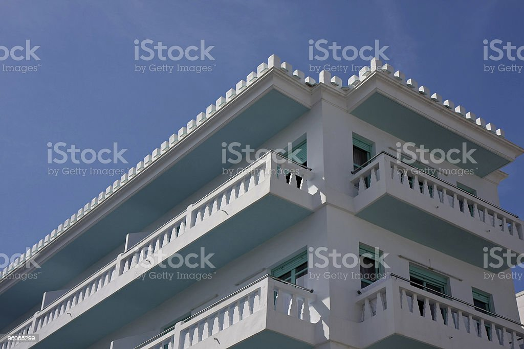 white and blue hotel facade with balconies royalty-free stock photo
