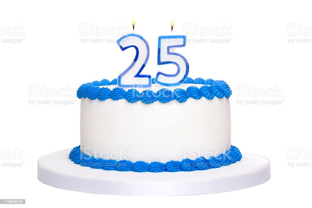 A white and blue iced 25th birthday cake with lit candles stock photo