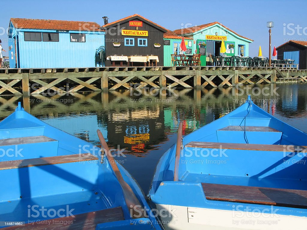 White and blue wooden boat stock photo