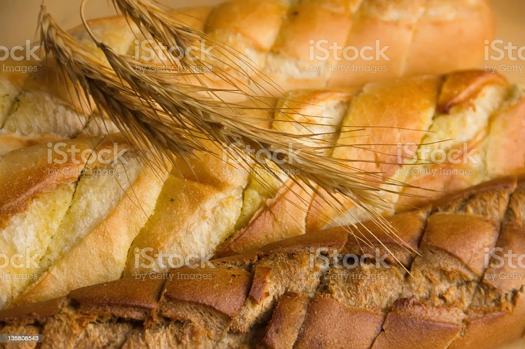 white and brown bread with wheat  spikelets stock photo