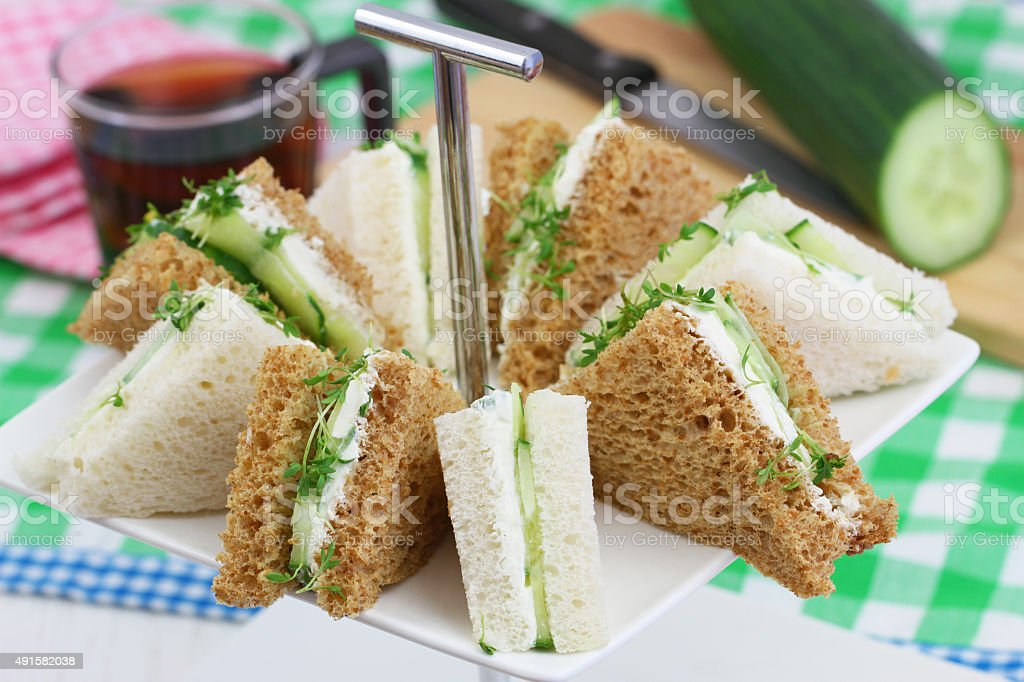 White and brown cream cheese and cucumber sandwiches stock photo