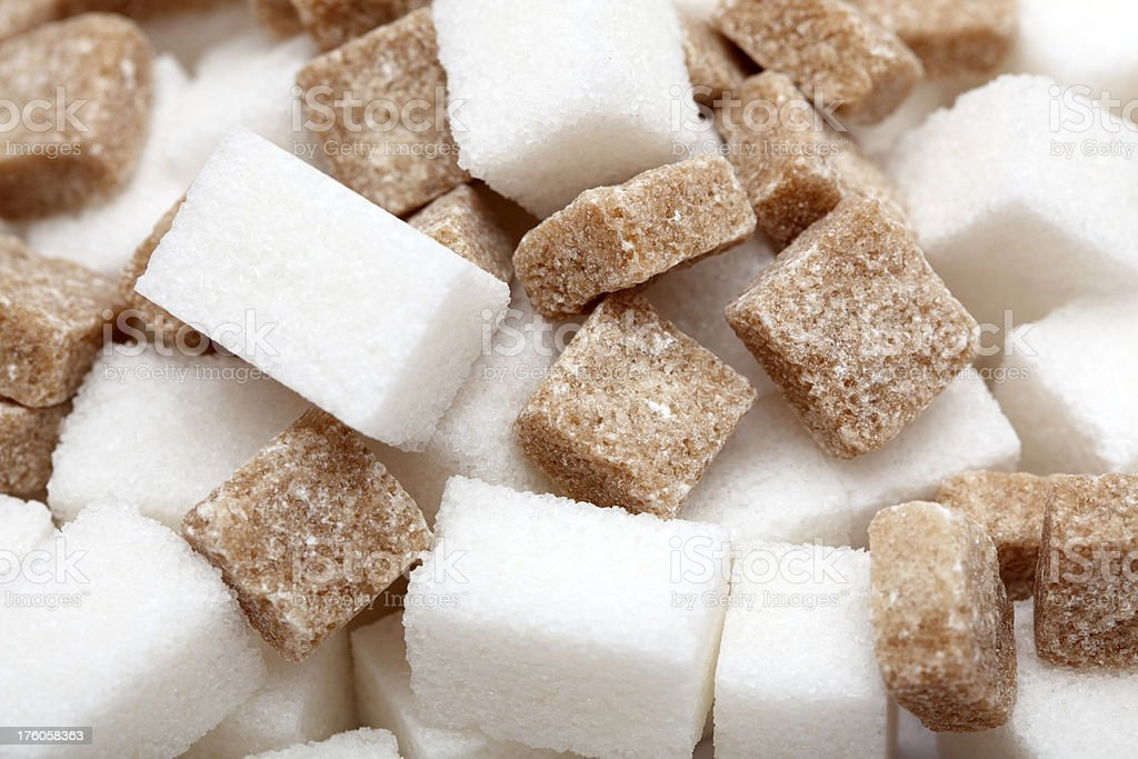 White and brown sugar cubes royalty-free stock photo