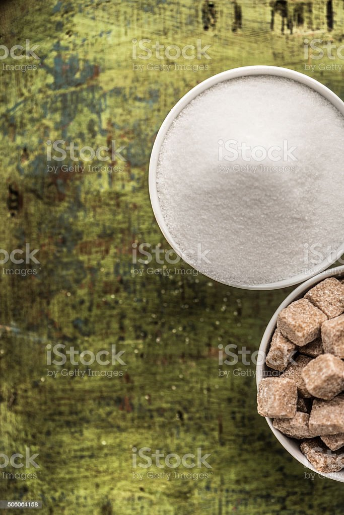 White and brown sugar stock photo