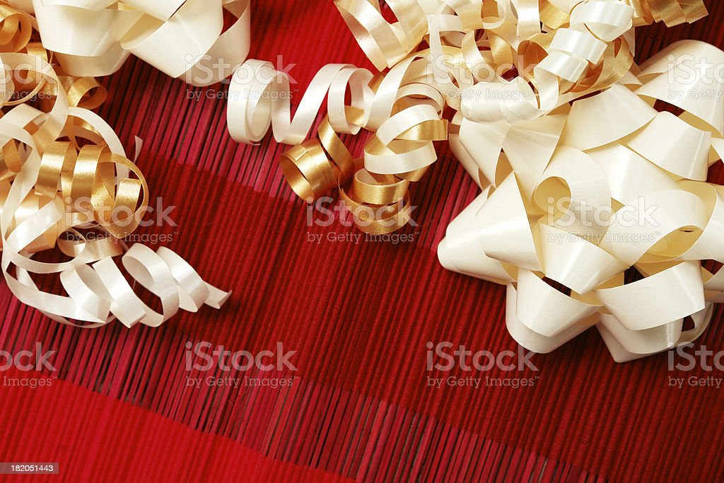 White and cream bows on red tablecloth royalty-free stock photo