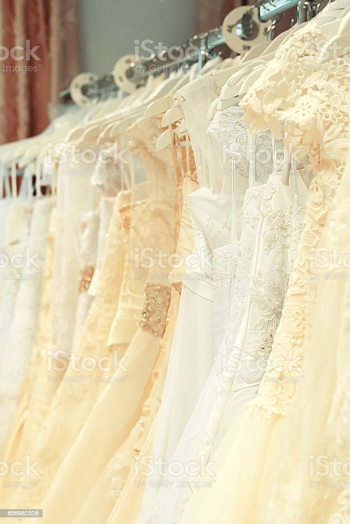 White and cream-colored wedding dresses vertical stock photo