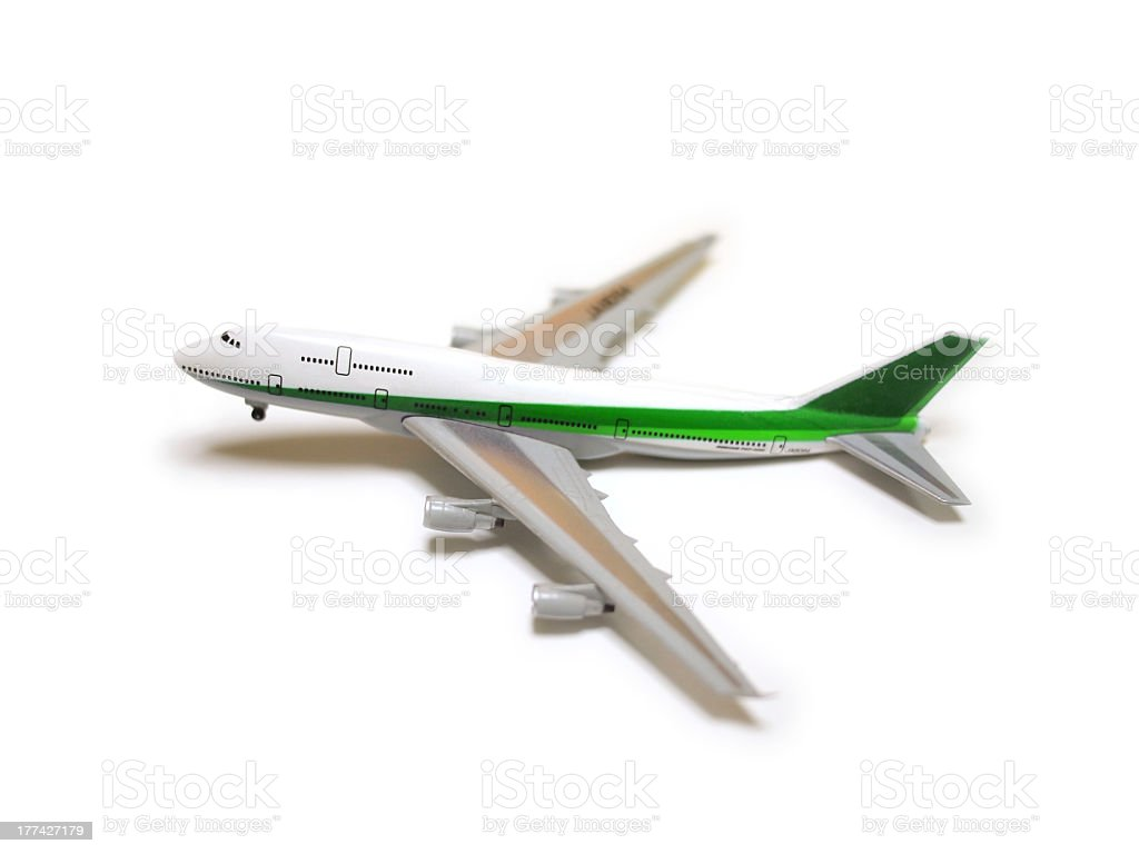 White and green model airplane ready for take off royalty-free stock photo