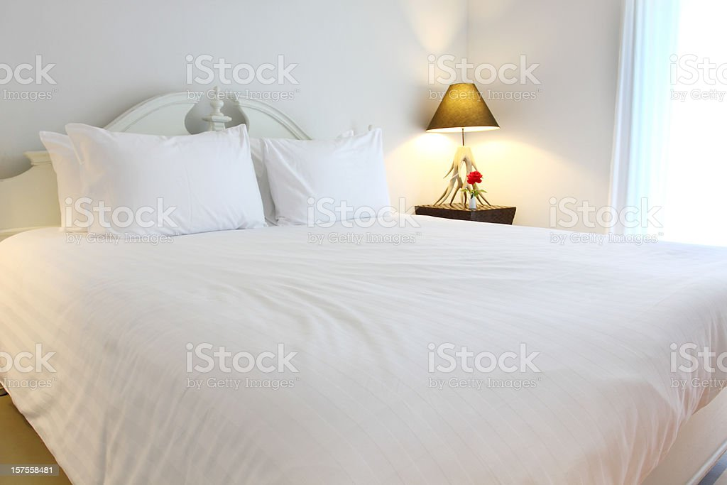 white and  luxurious hotel bedroom royalty-free stock photo