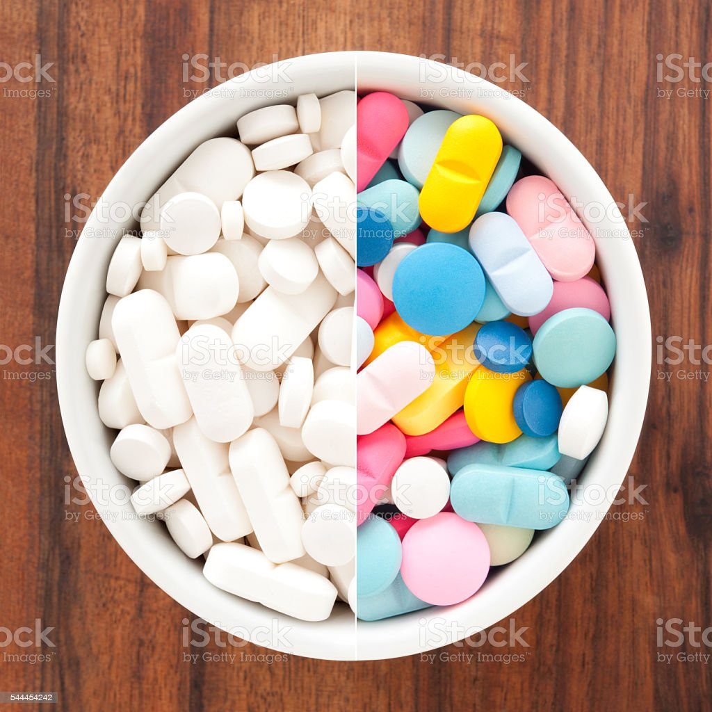 White and multicolored pills composition stock photo
