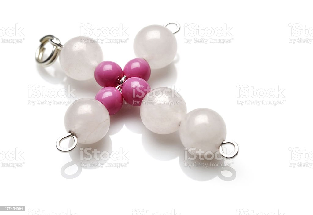 White and pink cross pendant royalty-free stock photo