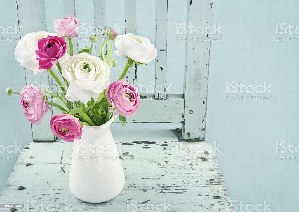 White and pink flowers on light blue chair stock photo