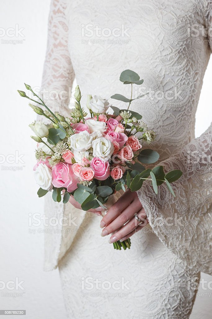 White and pink wedding bouquet of roses and lisianthus flowers stock photo
