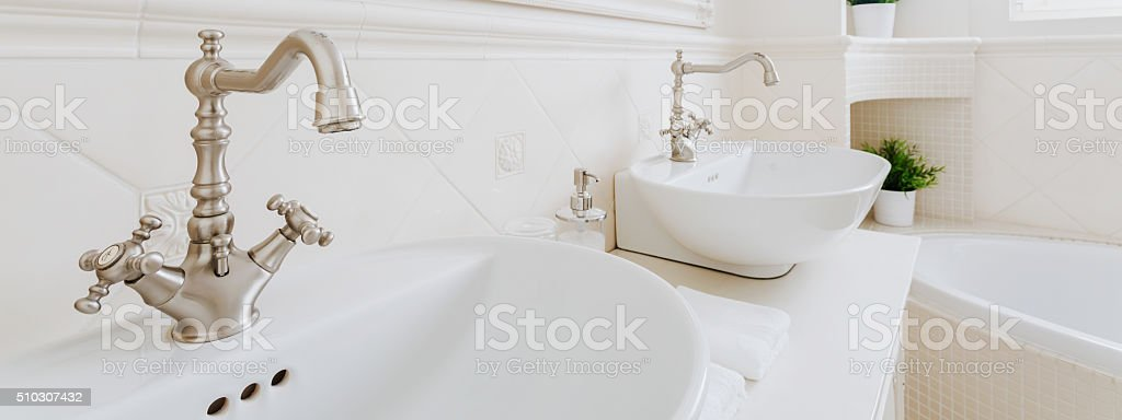 White and porcelain washbasins stock photo