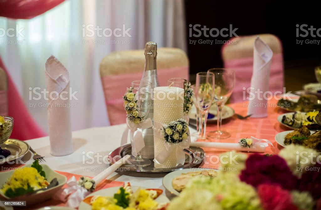 white and purple flowers, wedding accessories, wedding preparation, decorated wedding table with flowers, wedding flowers, wedding bouquet, food on the table,  decorated chairs, table and chairs, glasses, fruit, grapes, salad on the table stock photo