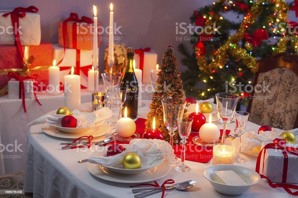 White and red decorations on the Christmas table royalty-free stock photo