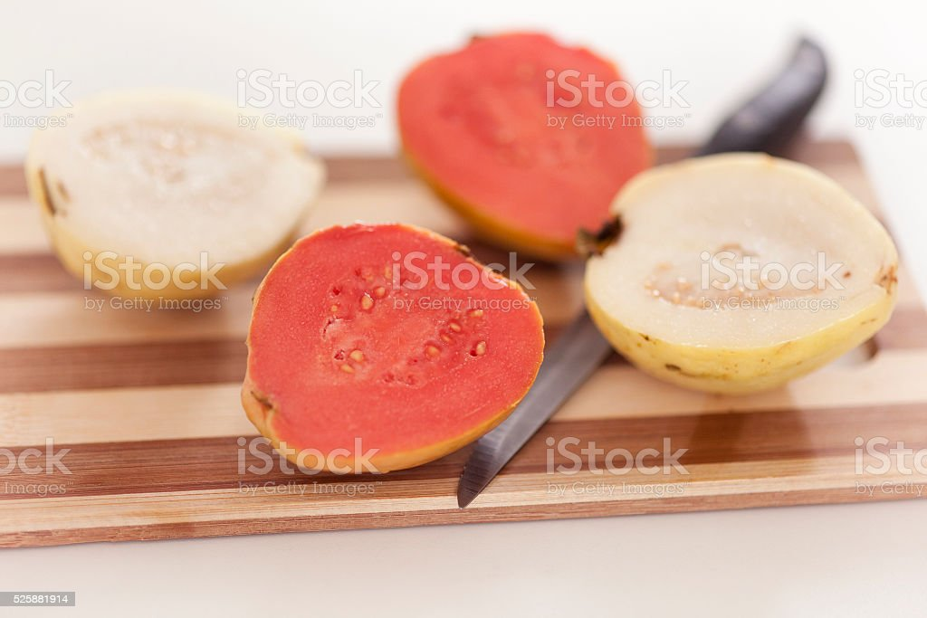 White and red guava fruit on cutting board stock photo