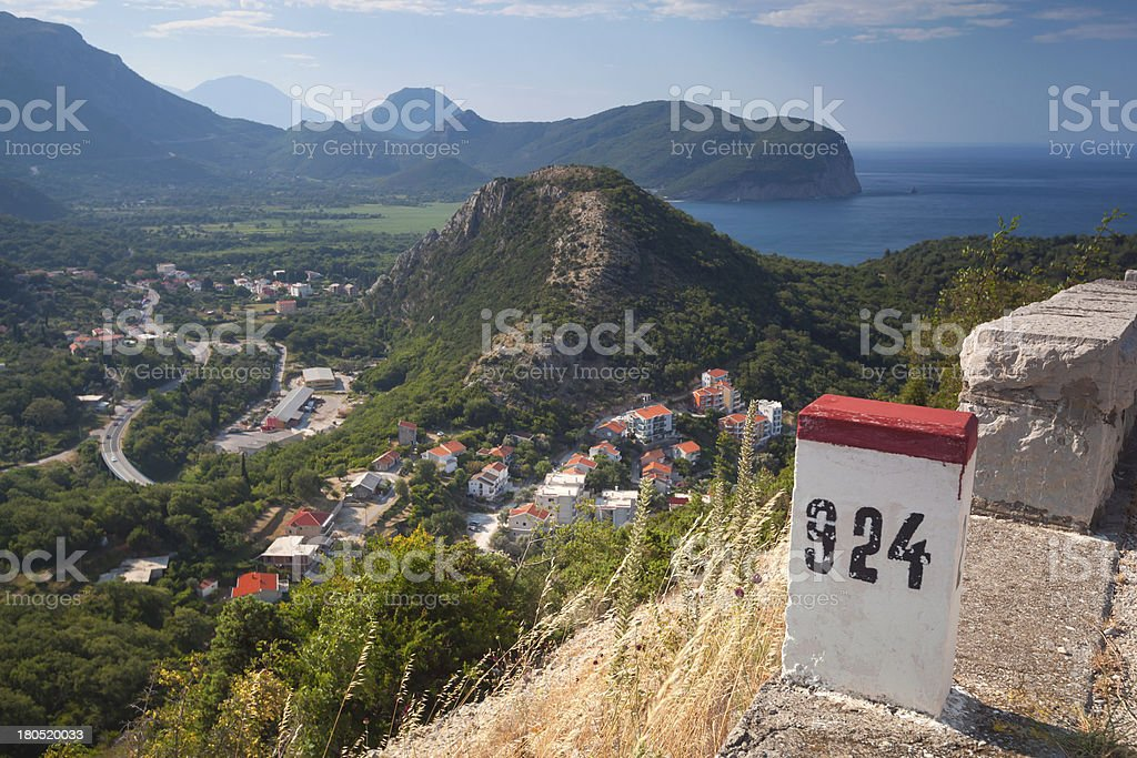 White and red kilometer stone post on the roadside stock photo