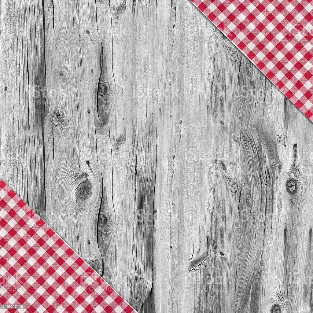 White and red tablecloth textile on wooden table stock photo