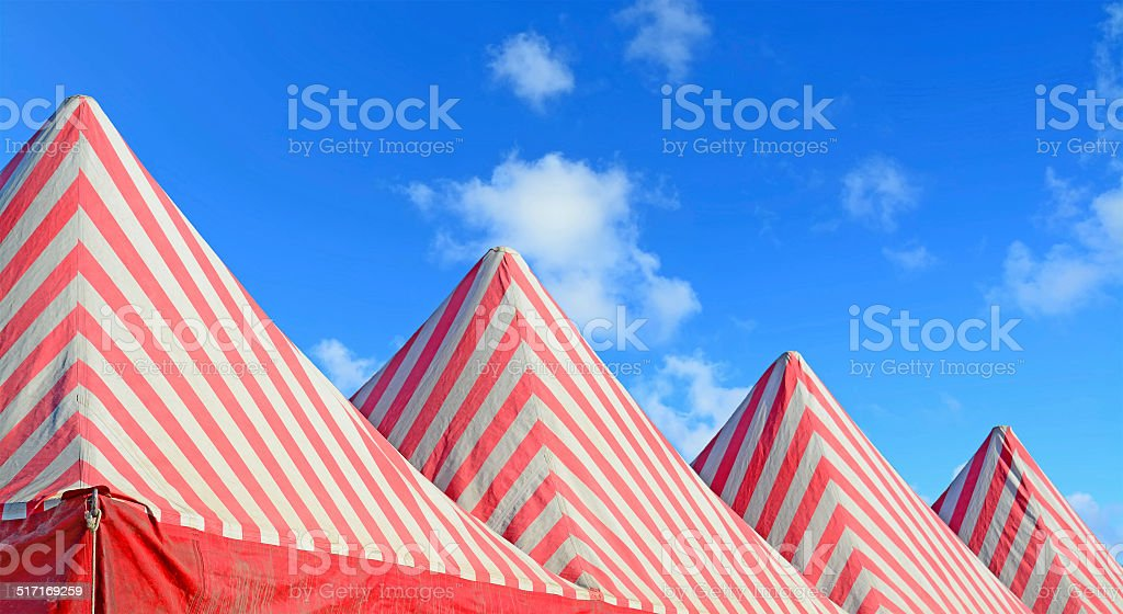 white and red tents stock photo