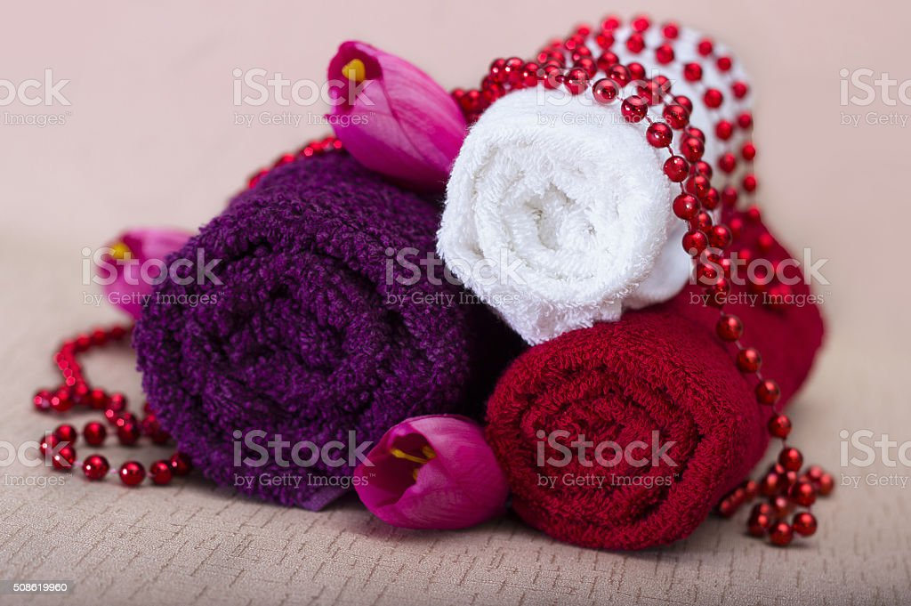 White and red towel around beads and flowers stock photo