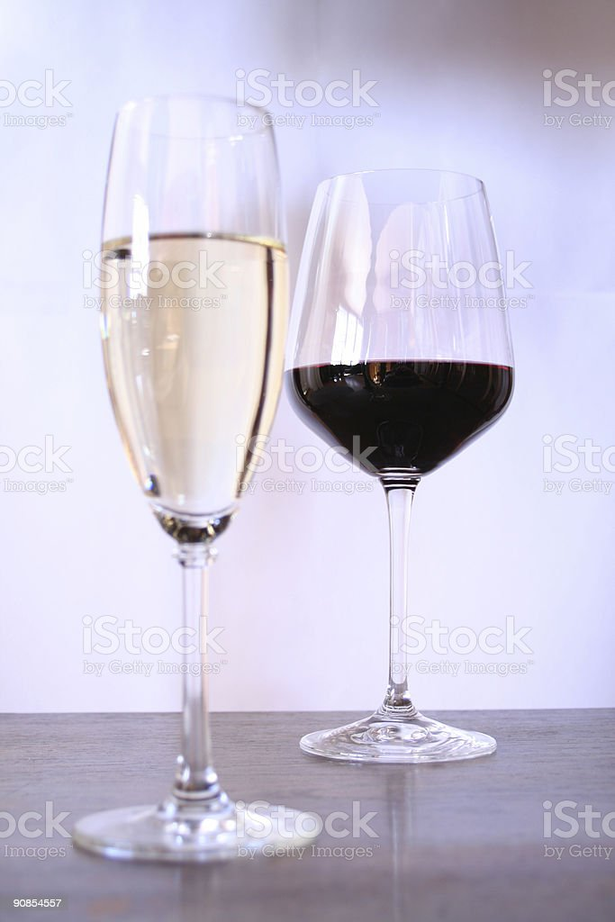 white and red wine, focus on redwine stock photo