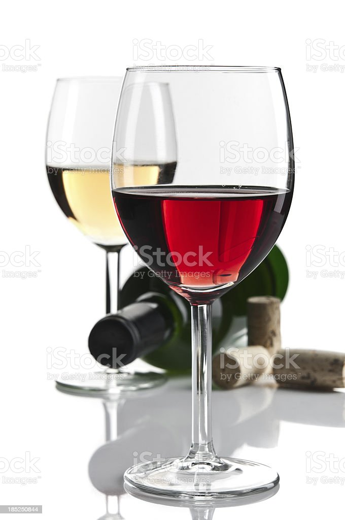 White and red wine glasses with bottle isolated stock photo