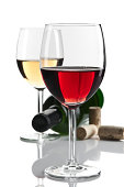 White and red wine glasses with bottle isolated