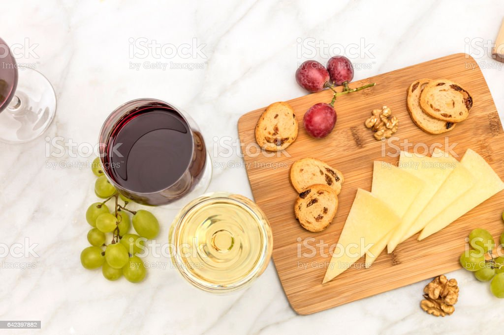 White and red wine with cheese, bread and grapes stock photo