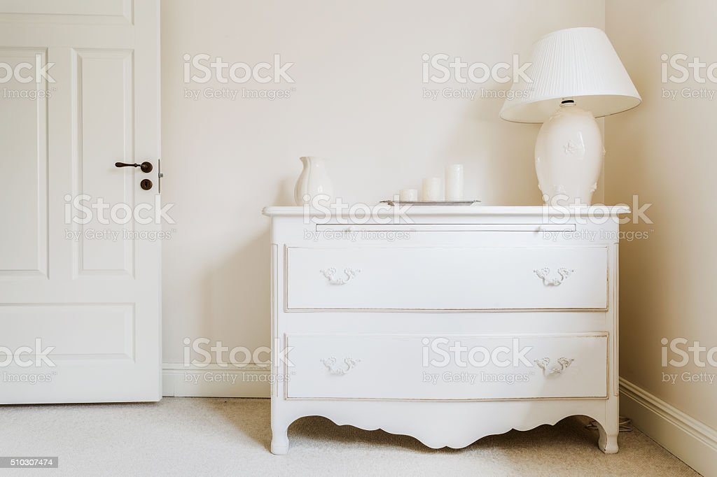 White and stylish commode stock photo