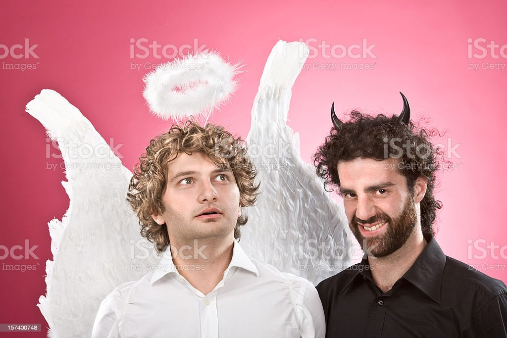 white angel and black devil together royalty-free stock photo