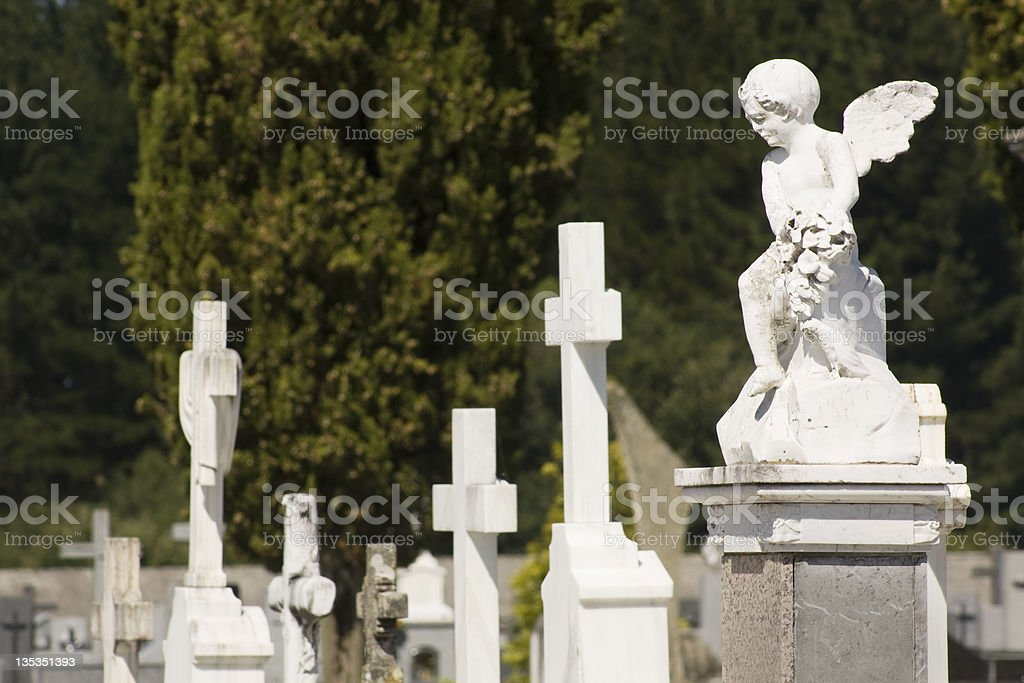 white angel and crosses stock photo
