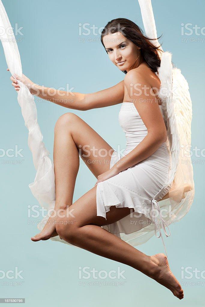 White Angel swaying on blue royalty-free stock photo