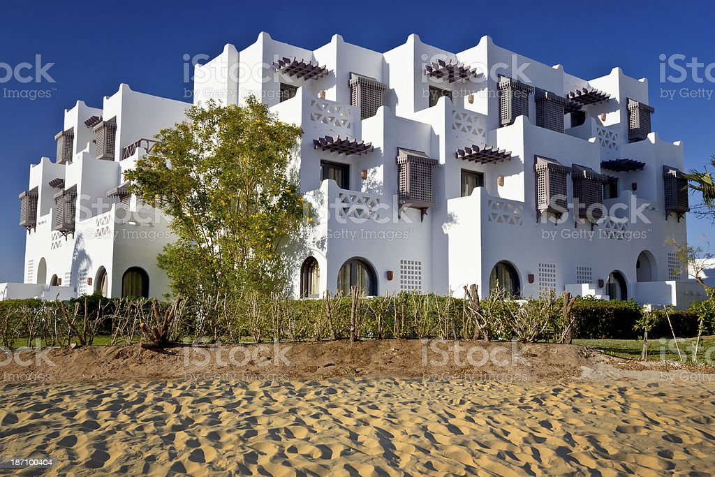 White apartment building in the Oasis stock photo