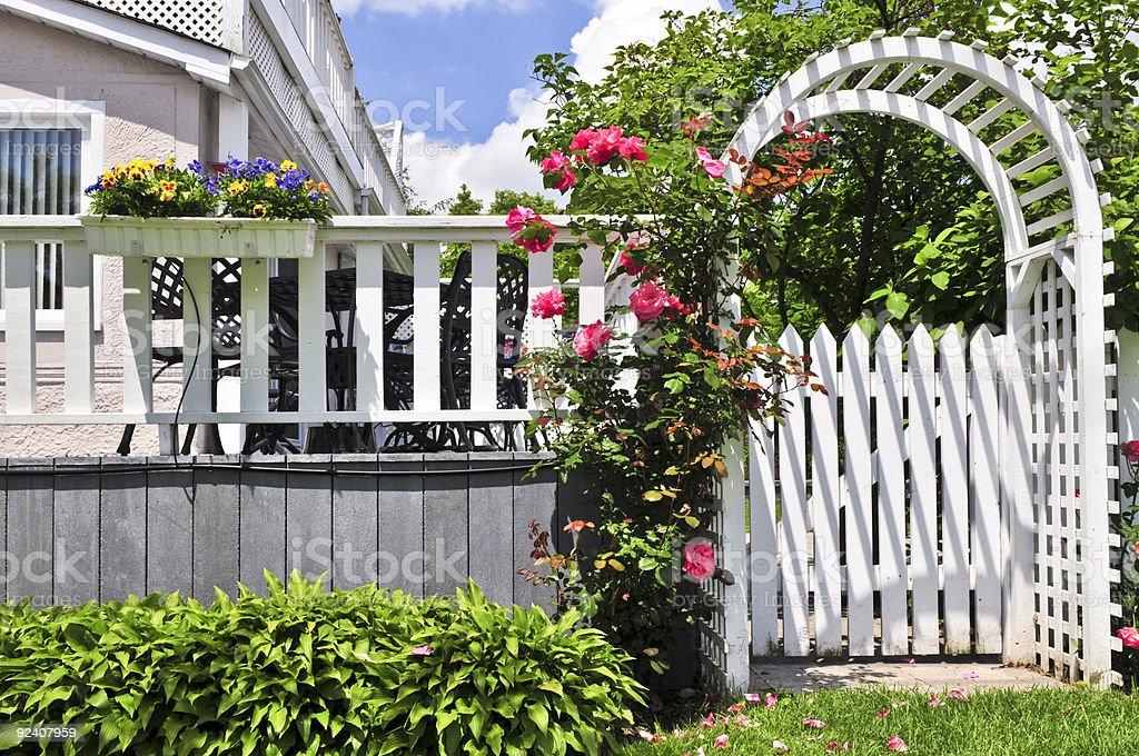 White arbor in a garden royalty-free stock photo