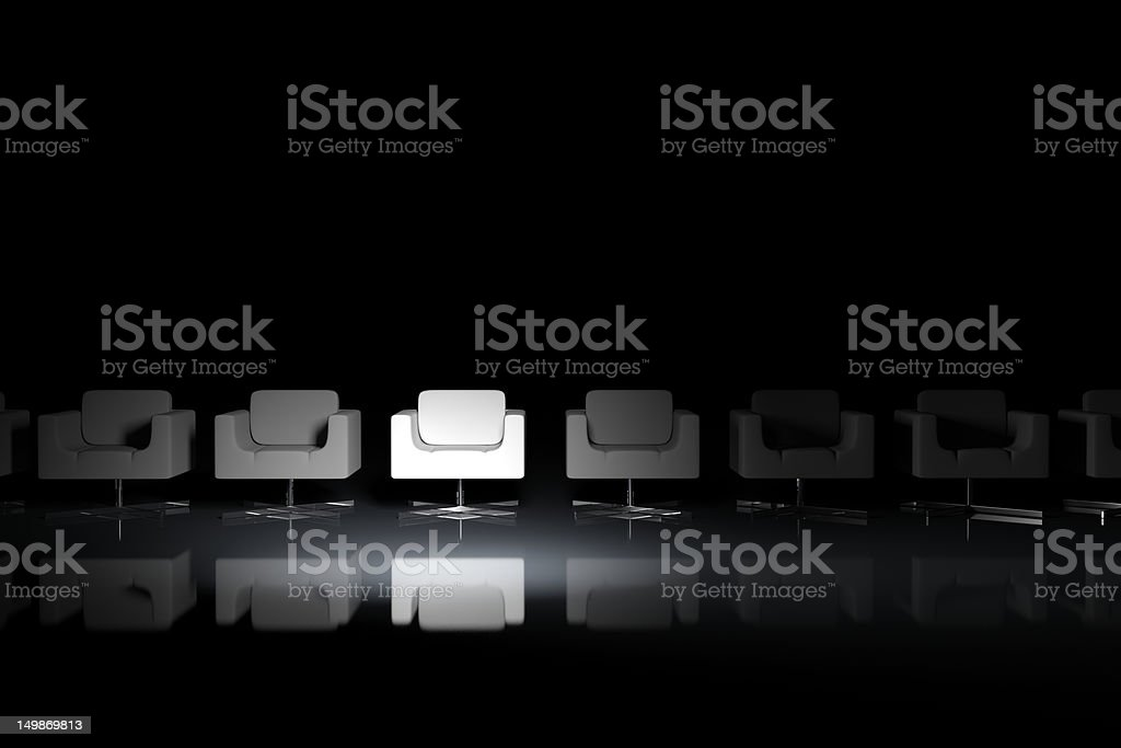 White armchairs on a black background royalty-free stock photo